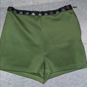 Army green form fitting shorts with leather studs